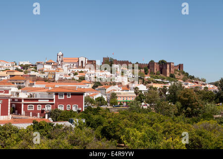Skyline view of the town of Silves with moorish castle and cathedral, Algarve, Portugal Europe - Stock Photo