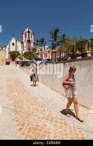 People walking down from Silves Cathedral ( Se Catedral ), Silves, Algarve, Portugal Europe - Stock Photo