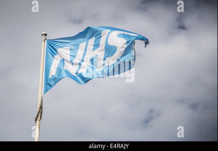 NHS flag flying on a flag pole in the wind - Stock Photo