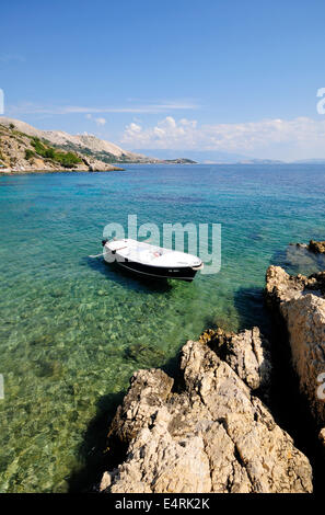 Beautiful transparent sea with a rowboat - Stock Photo