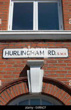 street name sign for hurlingham road, fulham, london, england, on a mansion block - Stock Photo