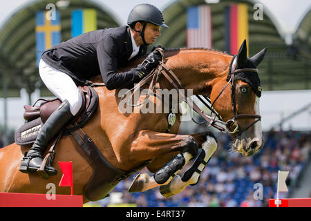Aachen, Germany. 16th July, 2014. German rider Marco Kutscher jumps over an obstacle on his horse 'Liberty Son 2' - Stock Photo