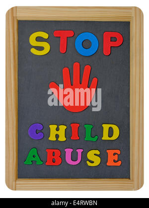 Stop child abuse in colored letters written on traditional slate - Stock Photo
