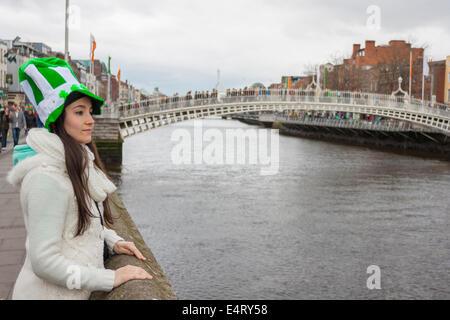 Girl at River liffey close to Hapenny bridge in Dublin - Stock Photo