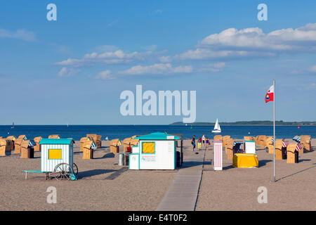 Roofed wicker beach chairs on the beach at Travemuende, Luebeck, Schleswig-Holstein, Germany - Stock Photo