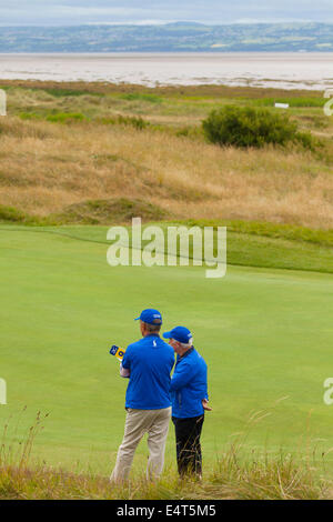 Hoylake, UK. 16th July, 2014. The Open Golf Championship. Course Marshals overlooking the 13th hole with Wales and - Stock Photo