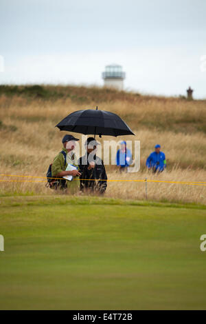 Hoylake, UK. 16th July, 2014. The Open Golf Championship. The forcasted rain begins to fall on the course - Stock Photo