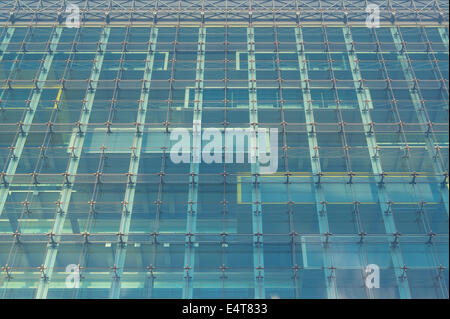 The glass curtain walling on the side of the Manchester Civil Justice Centre on Bridge Street in Manchester, UK. - Stock Photo