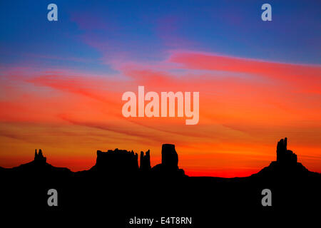 Sunrise over King on his throne, Stagecoach, Bear and Rabbit, The Castle and Big Indian rock formations, Monument - Stock Photo