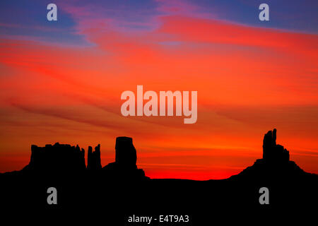 Sunrise over Stagecoach, Bear and Rabbit, The Castle and Big Indian rock formations, Monument Valley, Navajo Nation, - Stock Photo