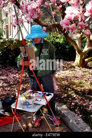 Washington, DC:  A woman with her easel painting in the Moongate Garden at the Smithsonian Museum on the National - Stock Photo