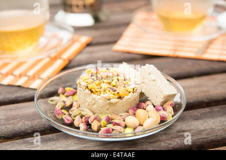 Halvah - paste of sesame with pistachios on the glass plate - Stock Photo