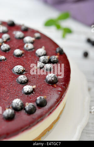 Black currant cheesecake with fresh berries on plate closeup - Stock Photo