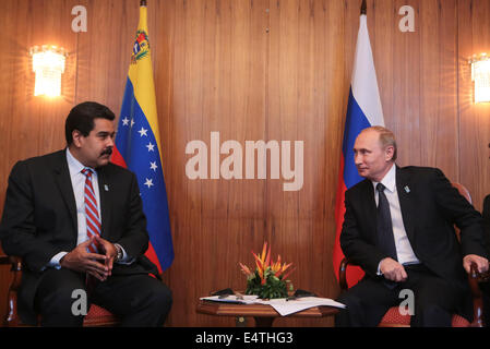 Brasilia, Brazil. 16th July, 2014. Venezuelan President Nicolas Maduro (L) meets with his Russian counterpart Vladimir - Stock Photo