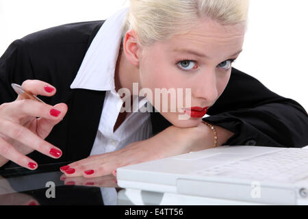 Bored blond receptionist - Stock Photo