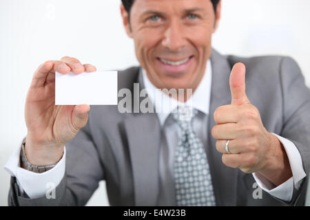businessman showing card - Stock Photo