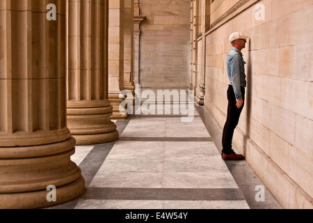 Arts Entertainer Mr James Everything standing face to the wall at the Caird Hall exhibiting one his new projects - Stock Photo