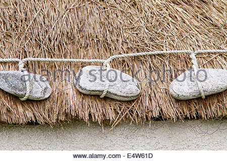 A detail of the roof of a traditional thatched croft at Howmore, Isle of South Uist, Outer Hebrides, Scotland. - Stock Photo