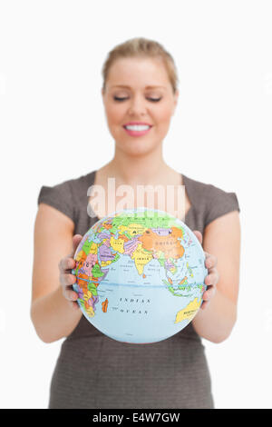 Woman looking a globe - Stock Photo