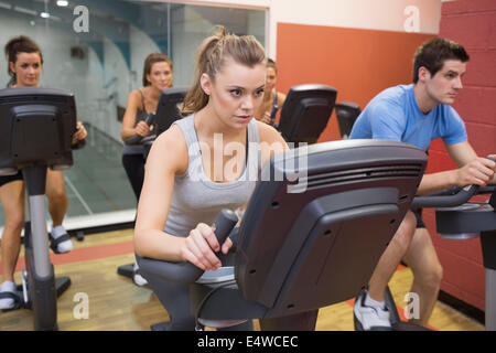 People working out at spinning class - Stock Photo
