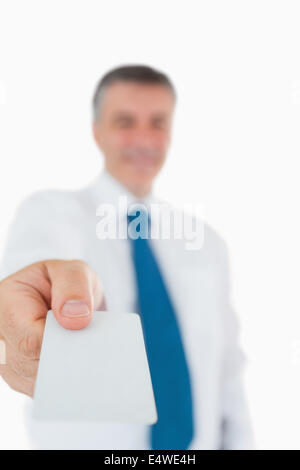 Businessman handing out card - Stock Photo