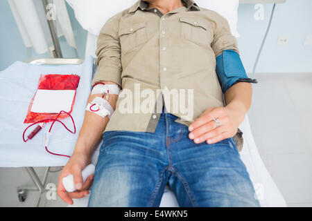 Male patient receiving a blood transfusion - Stock Photo