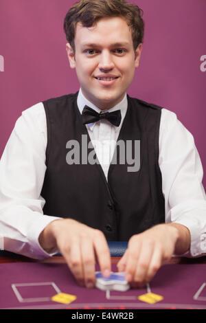 Dealer shuffling cards - Stock Photo