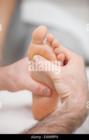 Sole of foot being massaged - Stock Photo