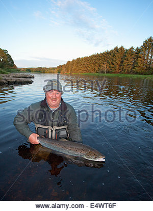 An angler fishing for salmon at the on the River Dee, Scotland - Stock Photo