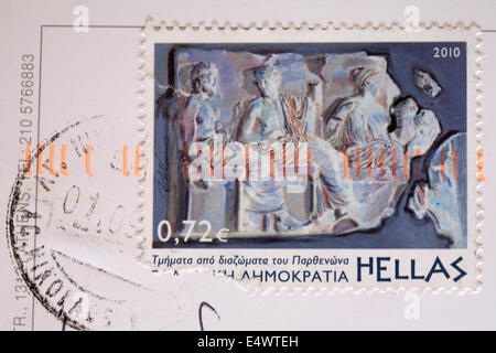 Greek stamp stuck on postcard - Stock Photo