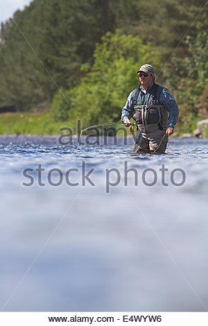 An angler fishing for salmon on the River Dee - Stock Photo
