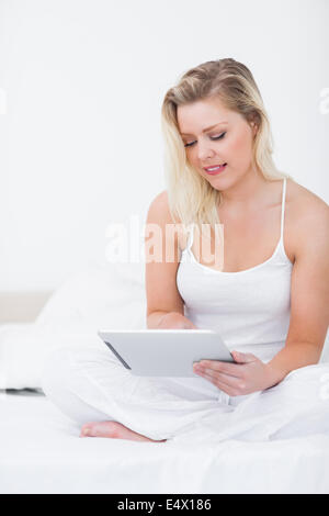 Pretty woman reading ebook sitting near the hearth stock photo young woman using an ebook while sitting stock photo fandeluxe Ebook collections