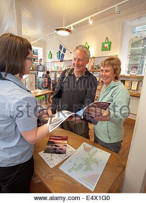 Helpful advice at Lerwick VisitScotland Information Centre, Lerwick, Mainland, Shetland, Scotland. - Stock Photo