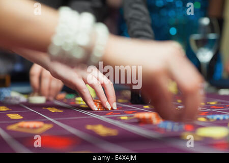 People placing bets - Stock Photo