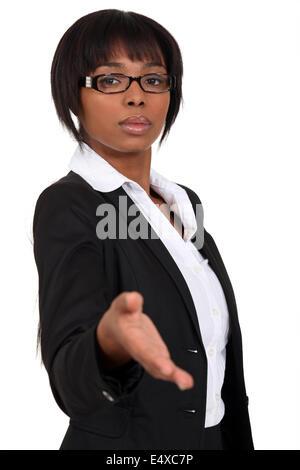 Afro-American businesswoman handshaking - Stock Photo