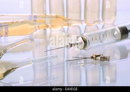 Medicine ampulas and syringe - Stock Photo