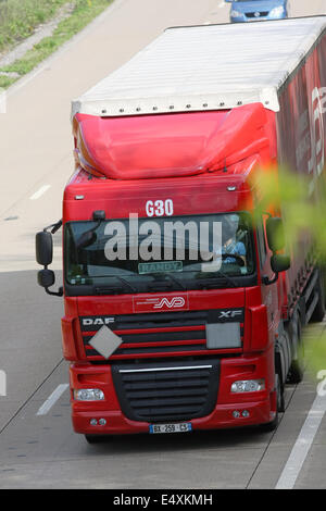 A Norbert Dentressangle articulated truck traveling along the M20 motorway in Kent, England - Stock Photo
