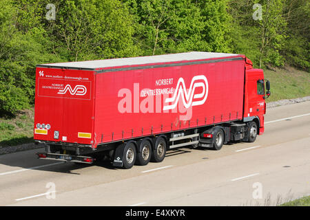A foreign articulated truck traveling along the M20 motorway in Kent, England - Stock Photo