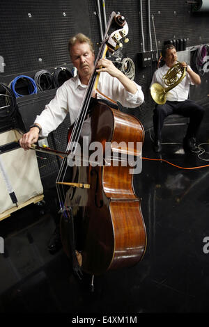 Boston Landmarks Orchestra musicians practice before a rehearsal in a recording studio - Stock Photo