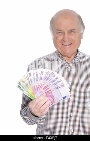Man holding lots of cash - Stock Photo