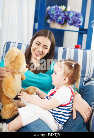 Happy smiling mother with one year old baby - Stock Photo
