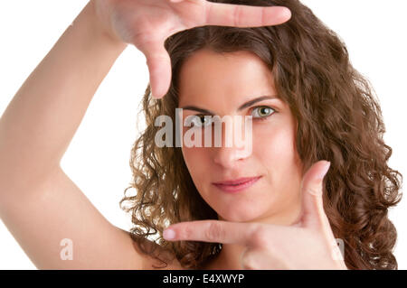 Woman Framing Picture - Stock Photo