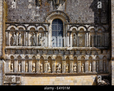 Statues in arched niches in the Romanesque facade of the medieval church of Saint Pierre in Perignac south western - Stock Photo