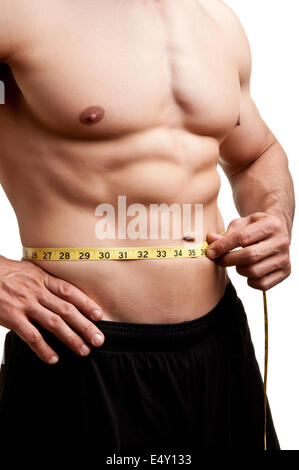 Fit Man Measuring His Waist - Stock Photo