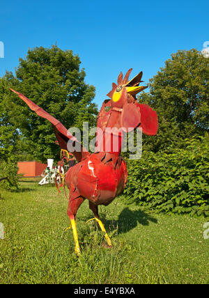 Homer, New York, USA, July 16,2014. Frog Pond Farm Folk Art Gallery. red rooster made of steel - Stock Photo