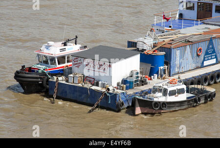 Boat service area on The River Thames London seen from Waterloo Bridge - Stock Photo