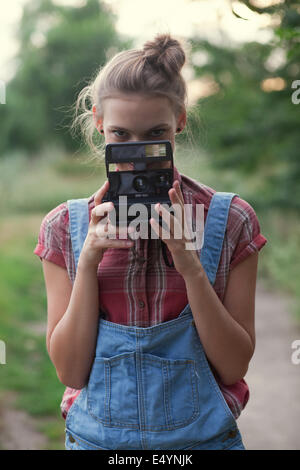 Girl photographer and instant camera - Stock Photo