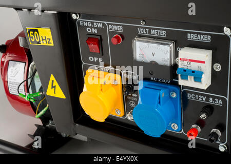 Electricity generator control panel;  with sockets, Volt meter, switches and circuit breakers. - Stock Photo