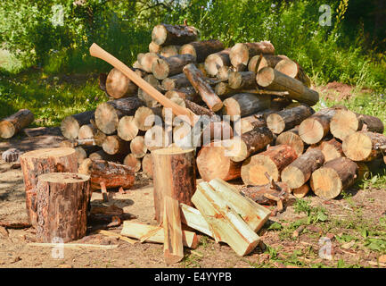 Pile of firewood and axe - Stock Photo