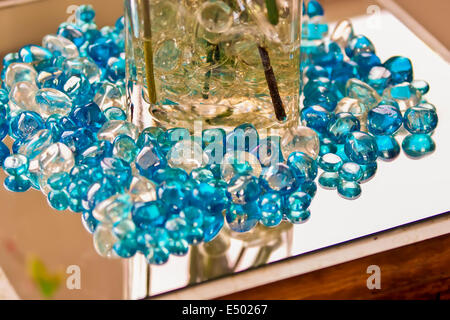 blue marbles on a reflective surface - Stock Photo